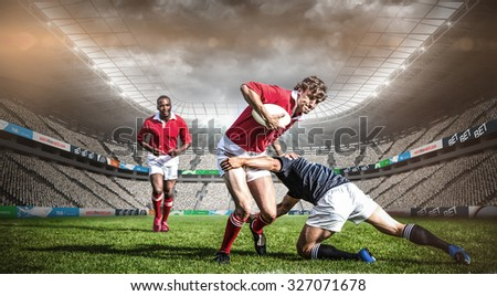 Rugby stadium against rugby players tackling during game Сток-фото ©