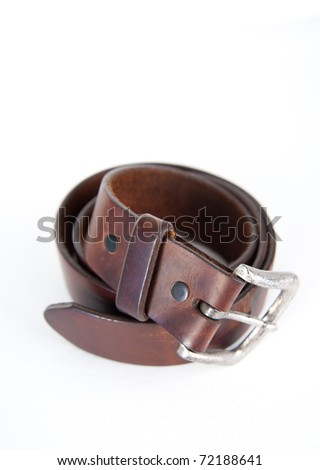 Rugged Brown Leather Jean Belt with Silver Buckle Isolated on White - stock photo