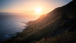 Rugged coastal mountains of Big Sur California at sunset