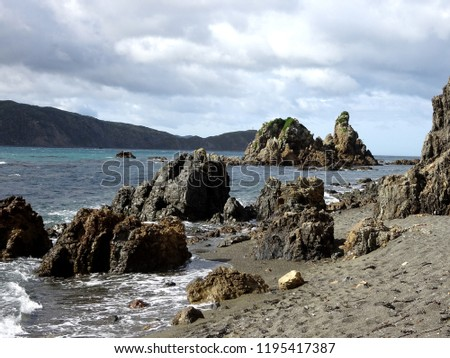 Rugged coastal scenery at mouth of Wellington harbour, an area subject to fierce storms and shipwrecks New Zealand