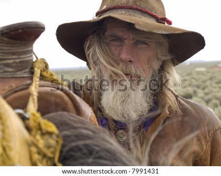 Rugged cowboy whisked by the wind