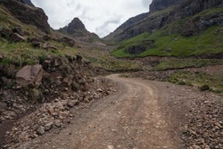 Rugged dirt road over mountain; Sani Pass on South Africa - Lesotho border.