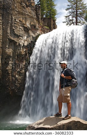 Rugged hiker views the wild terrain at Rainbow Falls in the Devils Postpile NM