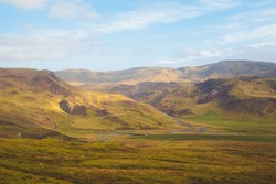 Rugged mountain Icelandic terrain in rural countryside landscape and valley in Hengill,  Iceland.