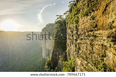 Rugged rock formation along cliff face at Katoomba, Blue Mountains National Park, a UNESCO World Heritage site. Distant viewing platform is Echo Point.