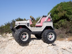 Rugged toy jeep on a pile of stone
