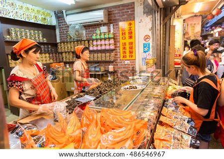 RUIFANG, TAIWAN - MAY 6, 2016: A shop located in Jiufeng, Taiwan. At present, Jiufen is a renowned tourist attraction representative of Taiwan. #486546967