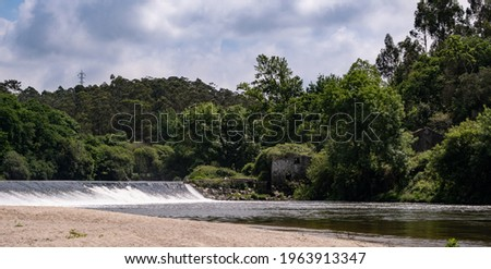 Ruin of old stone house on banks of Ave river in rural Portugal. Vila do Conde, Portugal.  Foto stock ©