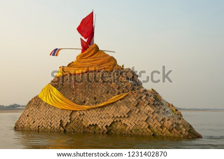 Ruin of the Phra Tad Klang Nam sunken chedi collapsed into Mekong river in 1847 in Nong Khai, Thailand.