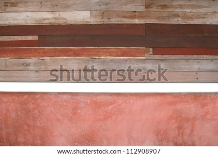 ruin wood and red concrete wall