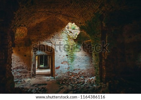Ruined ancient brick temple inside interior with doors, corridors and arch, vintage toned  #1164386116