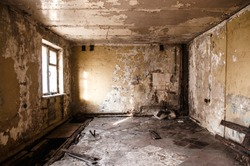 Ruined apartment of deserted hotel, old room with one window and damaged cracked walls, abandoned house, horror style interior, mystical place