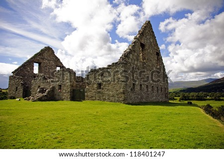 ruined cottage house building background in very beautiful part of Scotland with blue sky