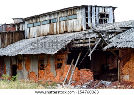 Ruined factory constructed of red bricks on crisis time