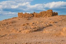 Ruined fort wall at Massada fortress in Negev desert, Israel