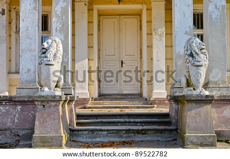 Ruined palace doors with lions figures. Zloty Potok , Poland.