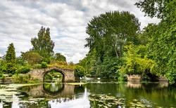 Ruined stone bridge across the Avon river in Warwick, England