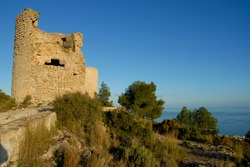 Ruined windmills on La Plana, the headland above Javea on the Costa Blanca, Alicante Province, Spain