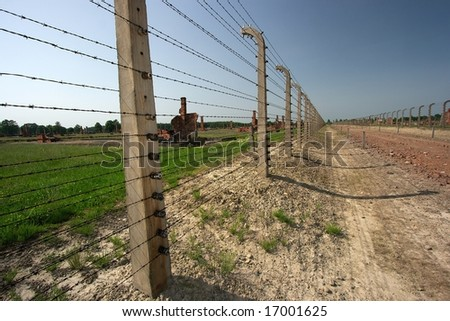 Ruins and barbed wire fences in Auschwitz