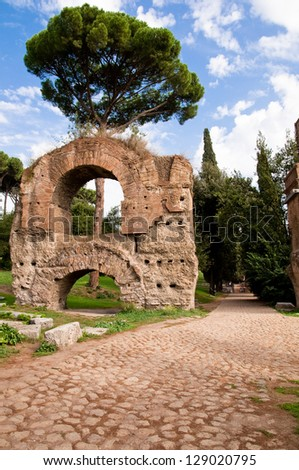 Ruins from Acquedotto Cladio and stone street in Palatine Hill at Rome - Italy