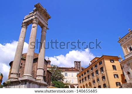 Ruins from the ancient Rome seen next to houses and apartments in the very center of Rome on aq sunny day