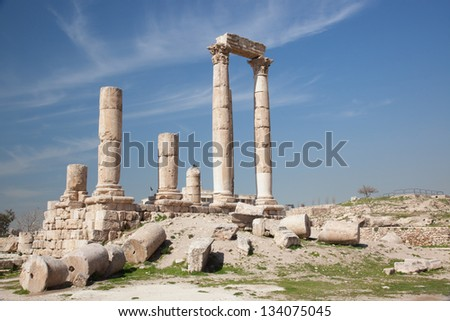 Ruins from the Middle East city of Amman, Jordan bronze age site called the Citadel, with the modern city in the background