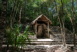 Ruins in ancient Mayan city in the jungle. Coba Archeological Area, Yucatan, Mexico