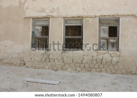 Ruins in the fabled 'ghost town' of Al Jazeera Al Hamra in Ras Al Khaimah emirate in the United Arab Emirates. Abandoned in the 1960s, the ruins feature traditional Emirati architectural elements.