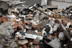 Ruins of a broken building, for photoshop. Grunge Wallpaper. Concrete industrial buildings collapsed. Dismantling an old building. Abandoned Industrial Buildings. House in ruins.Industrial background.