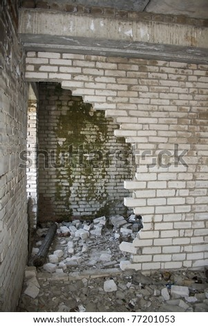 Ruins of a destroyed house. Abandoned building. War time