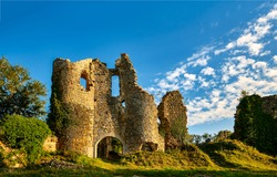 Ruins of a medieval castle. Ruined tower of medieval fortress. Medieval ruins. Ruined building