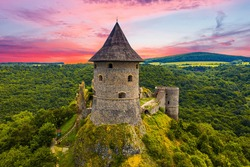 Ruins of a medieval castle Somoska on borders of Slovakia and Hungary at sunset time. Southern Slovakia