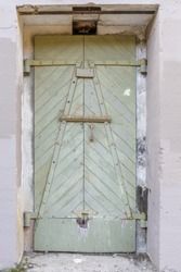 Ruins of a metal door at Battery West. Presidio of San Francisco, California, USA.