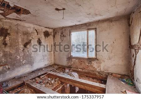 Ruins of a room on the floor with broken floor