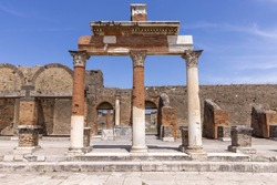 Ruins of an ancient city destroyed by the eruption of the volcano Vesuvius in 79 AD near Naples, Pompeii, Italy. Portico in front of the entrance to the Macellum