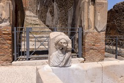 Ruins of an ancient city destroyed by the eruption of the volcano Vesuvius in 79 AD near Naples, Pompeii, Italy. A fountain for public use on one of the streets