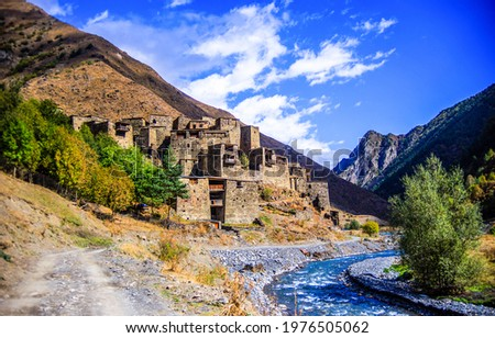 Ruins of an ancient mountain village. Mountain village ruins. Ancient village in mountains. Mountain village view