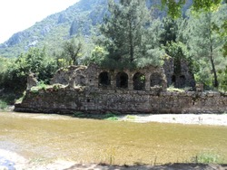 ruins of an ancient settlement on the river bank
