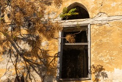 Ruins of an old abandoned building damaged during the war, (Karabakh) natural disasters and destruction, broken walls and ceilings. Demolition, earthquake, explosion, terrorist attack or natural disas