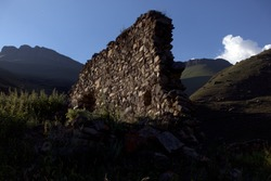 Ruins of an old house in the misty hills. The walls of the old kosh in the mountains. Ruins of the old settlement Shyky. The Balkan poet Kazim Mechiev lived in this village.Caucasus, Russia.