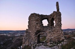 Ruins of ancient and abandoned fortress or tower or castle or fort Calamita in Inkerman, Sevastopol, Crimea. Medieval historic stone building on mountain