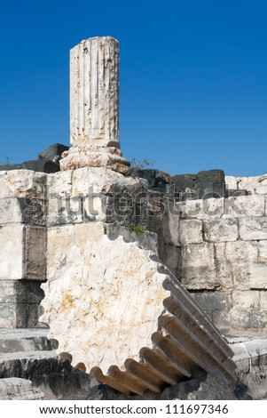 Ruins of ancient buildings with split along columned in the foreground