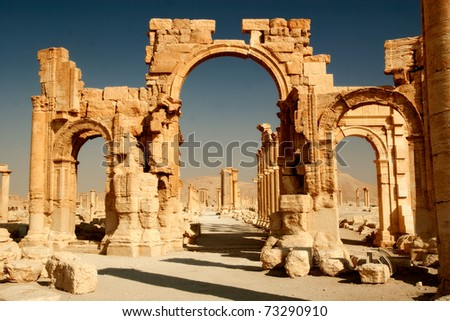 Ruins of ancient city of Palmyra in Syria desert.