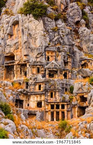 Ruins of ancient lycian rock tombs in town Demre. Ancient Myra city. Antalya province, Turkey Сток-фото ©