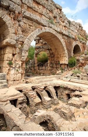 Ruins of ancient public Roman baths in Perge, Antalya, Turkey