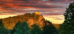 Ruins of Chojnik Castle in Karkonosze mountains at sunset. Poland