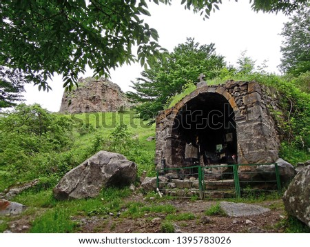 Ruins of church on Stone Forest hills, that surrounding town Goris in Armenia. Though building of church was ruined during earthquake, local people still take care of sacred altar's remains #1395783026