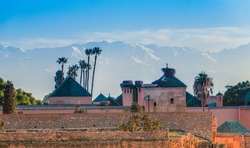 Ruins of El Badi Palace with the Atlas mountains in the background, Marrakech, Morocco. Commissioned by the Arab Saadian sultan Ahmad al-Mansur, sometime shortly after his accession in 1578