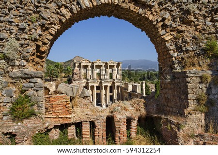 Ruins of Ephesus with a view over the roman library of Celsus, through an arch.