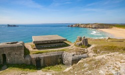 ruins of German WWii atlantic-wall bunkers at the rocky coastline of Brittany, France